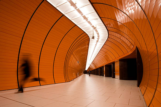 running commuter in modern organge subway tube - munich train station bildbanksfoton och bilder