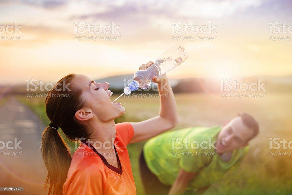 Running couple having break stock photo