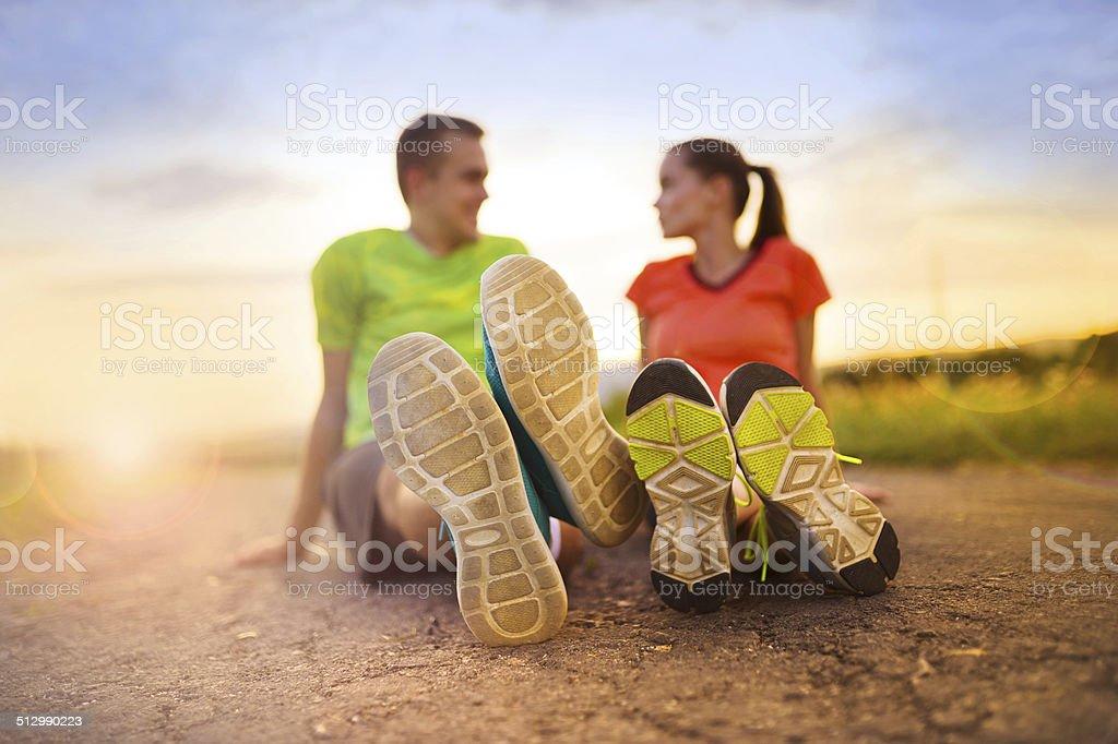 Running couple stretching stock photo