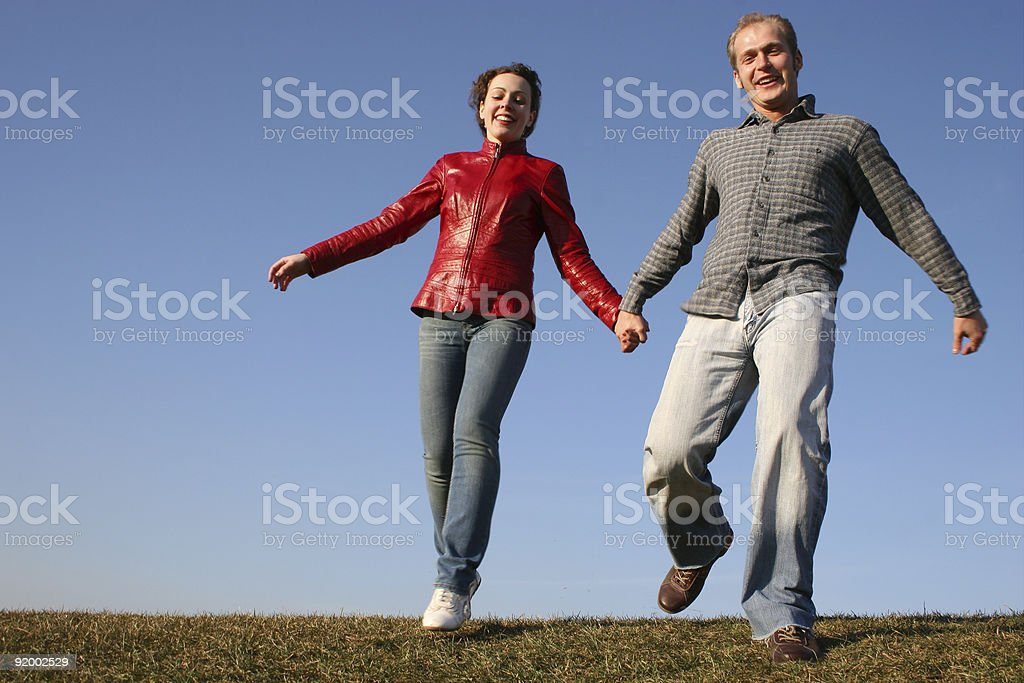 running couple with natural light stock photo