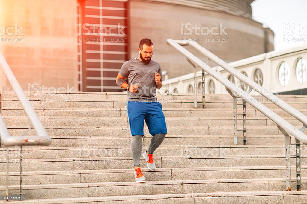 Running Downstairs in the city. stock photo