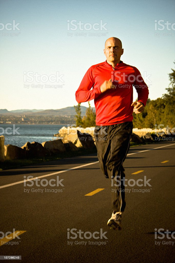 Running during sunset royalty-free stock photo