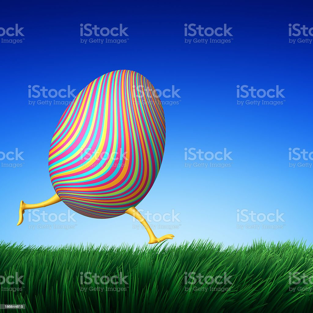 Running Easter Egg on grass field royalty-free stock photo