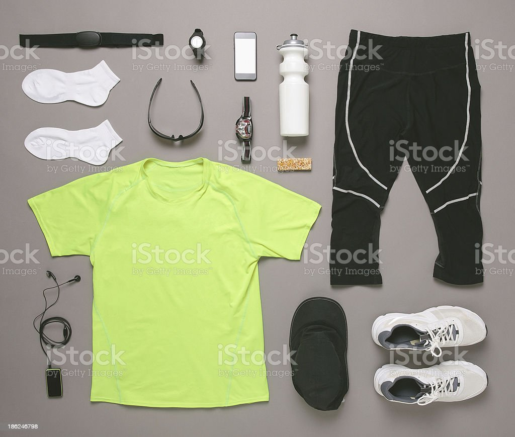Running equipment man on grey background. stock photo