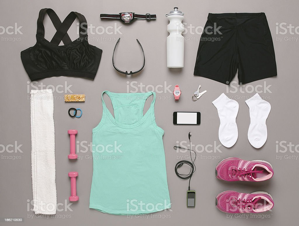 Running equipment woman on grey background. stock photo