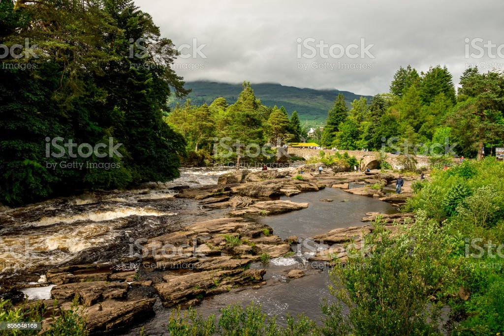 Running falls of Dochart in a small town of Killin in central Scotland stock photo