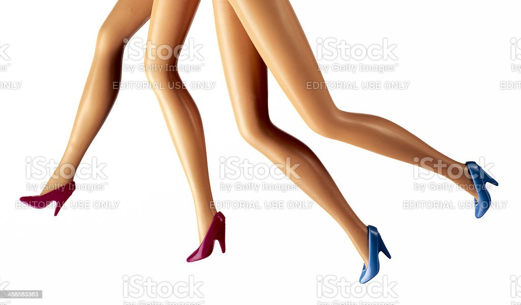 running female fashion doll legs stock photo