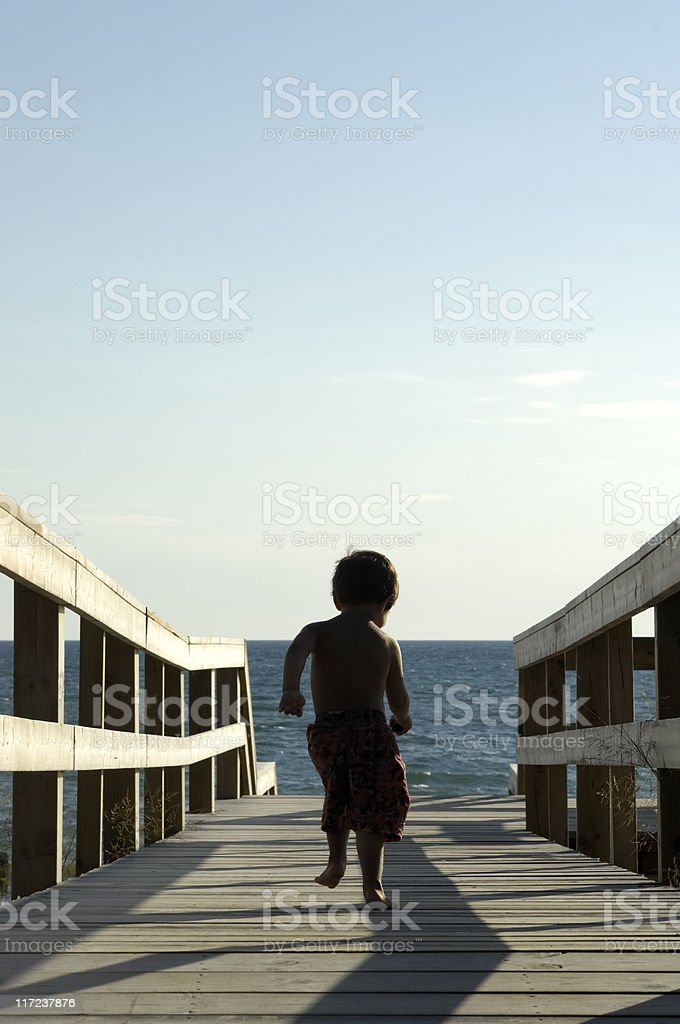 Running for an evening swim stock photo