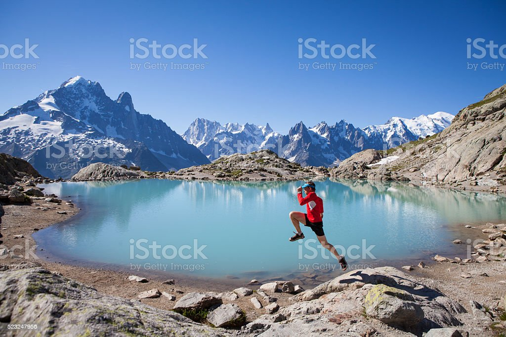 Running for joy at Lake Blanc Chamonix stock photo