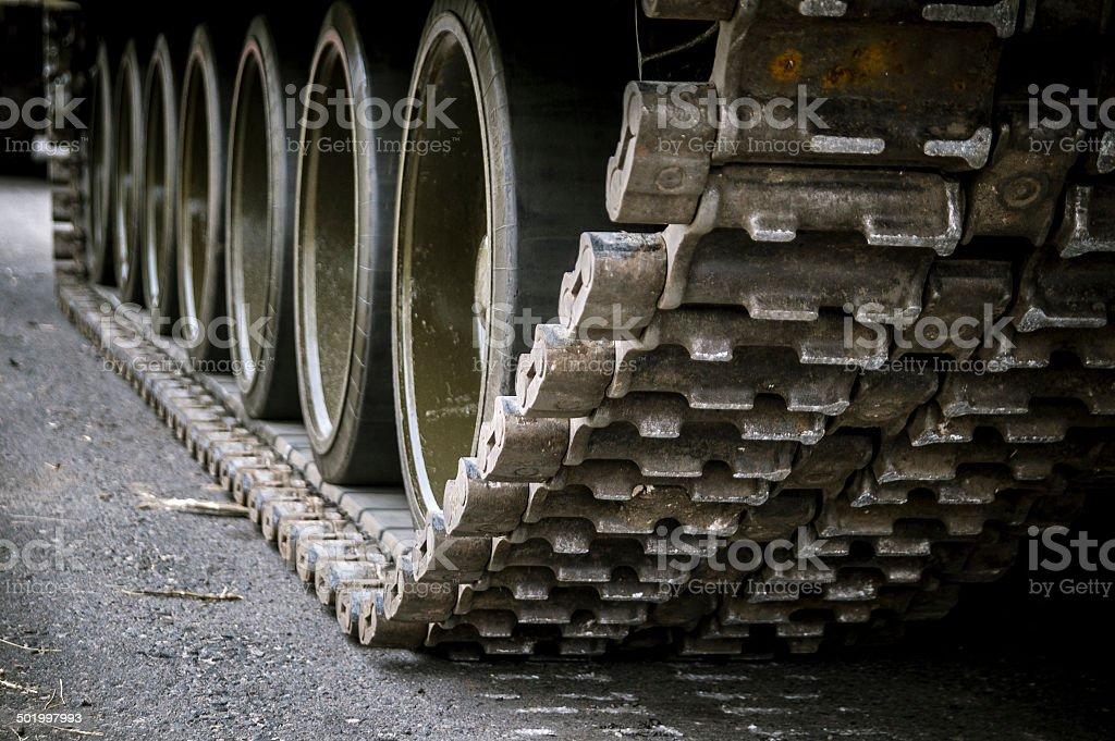 Running gear of the tank on asphalt stock photo