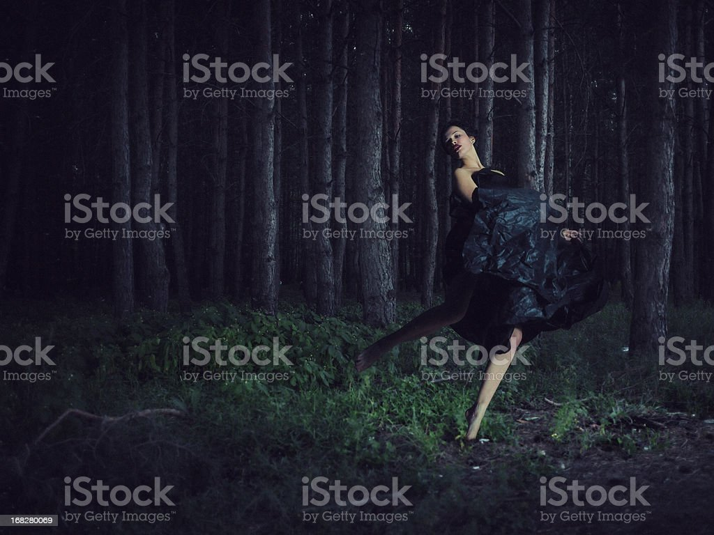 running girl in night forest stock photo