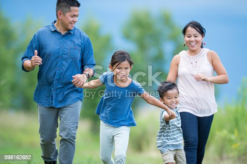 589135214 istock photo Running Happily Through a Meadow 598162652