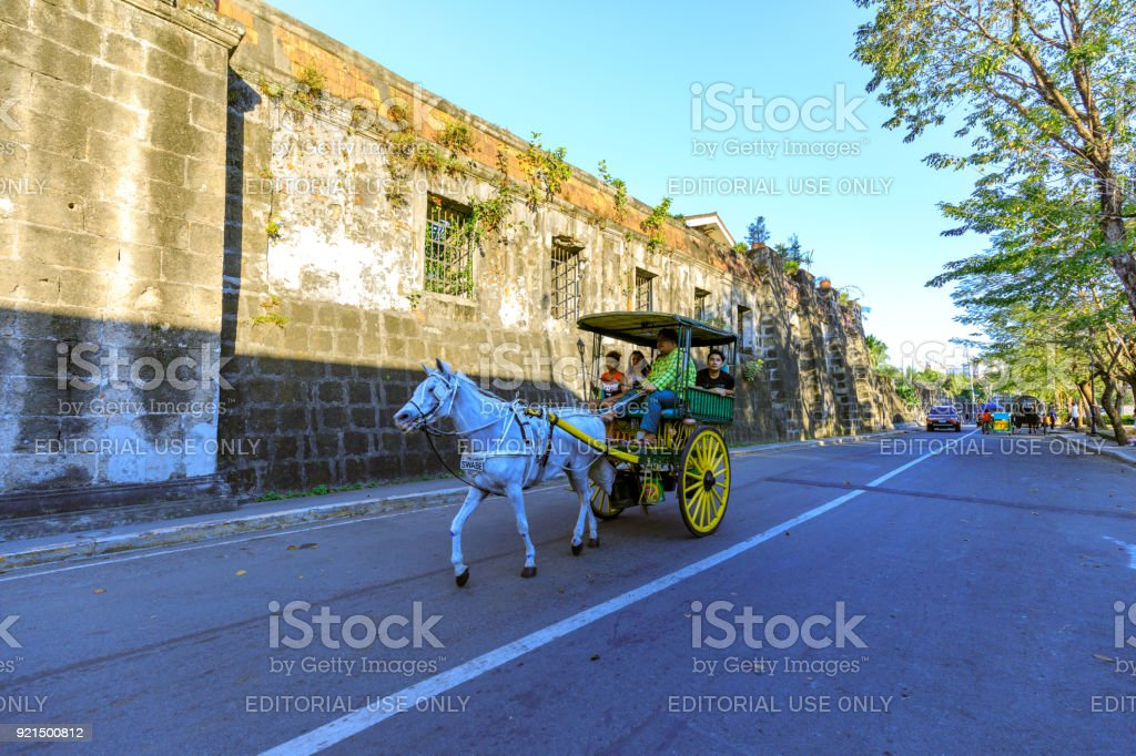 Running Horse with carriage with tourists in Intramuros district stock photo