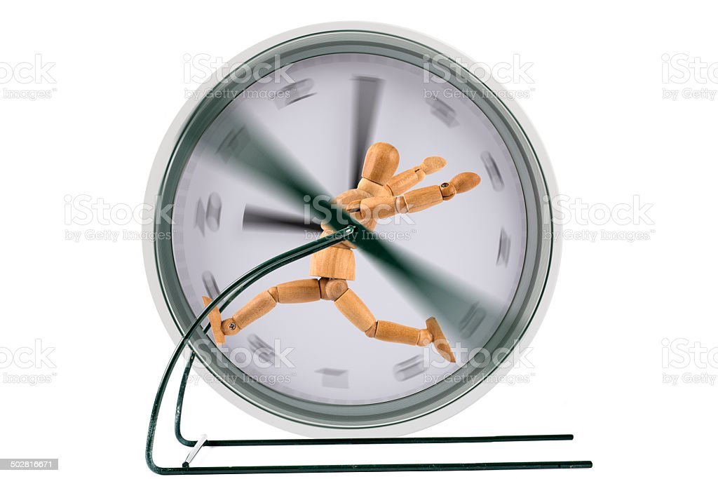running in a clock treadmill   - wooden mannequin in panic stock photo