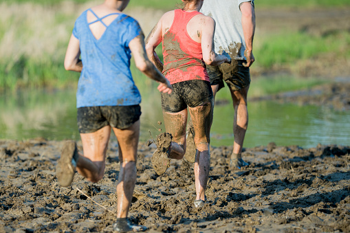 687723318 istock photo Running in a Mud Run 687722912