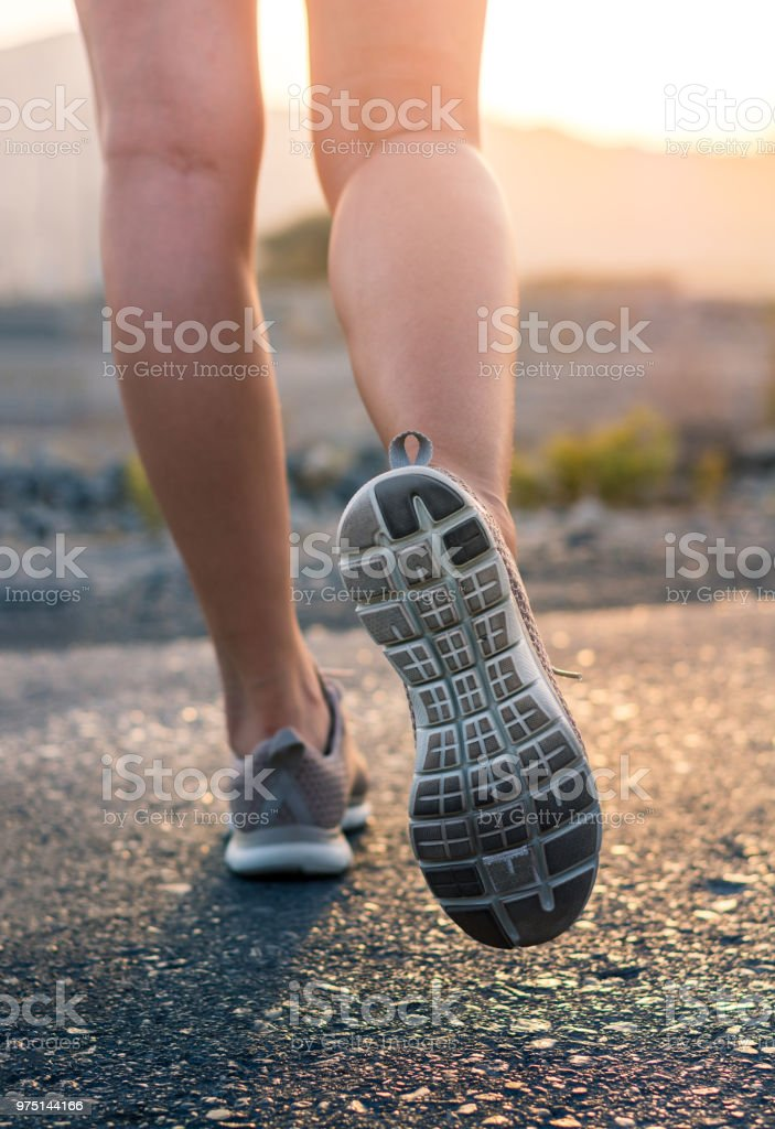 Running in the desert low angle view stock photo