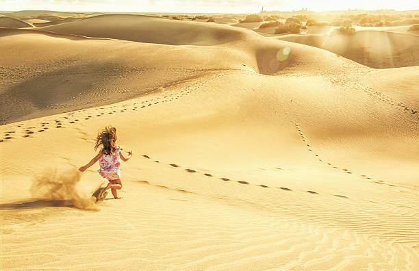 Running in the dunes of Maspalomas - Gran Canaria stock photo