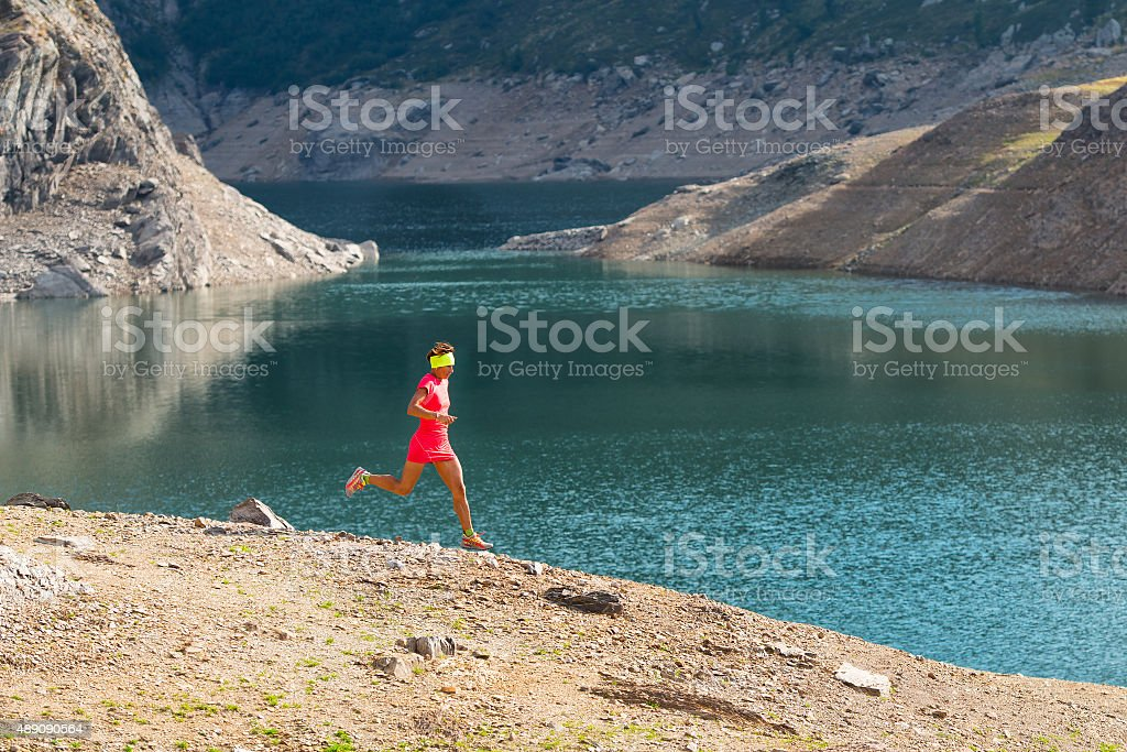Running in the great outdoors mountain among the alpine lakes stock photo