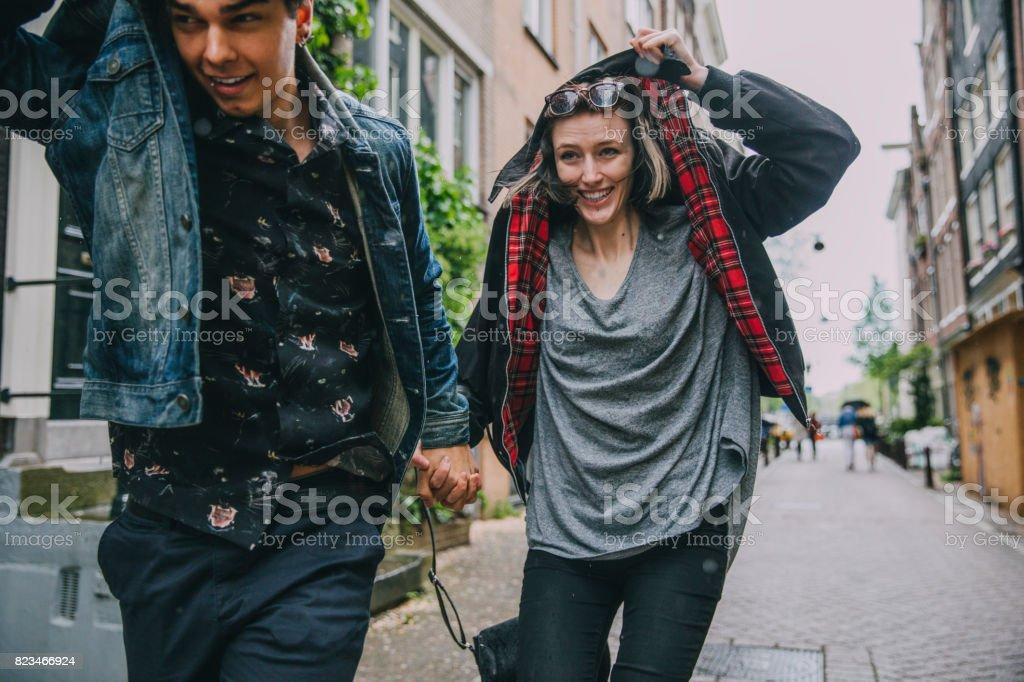 Running In The Rain In Amsterdam stock photo
