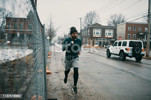 Close up of a young man running