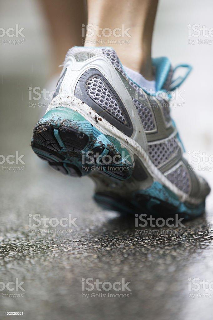 running in the rain stock photo