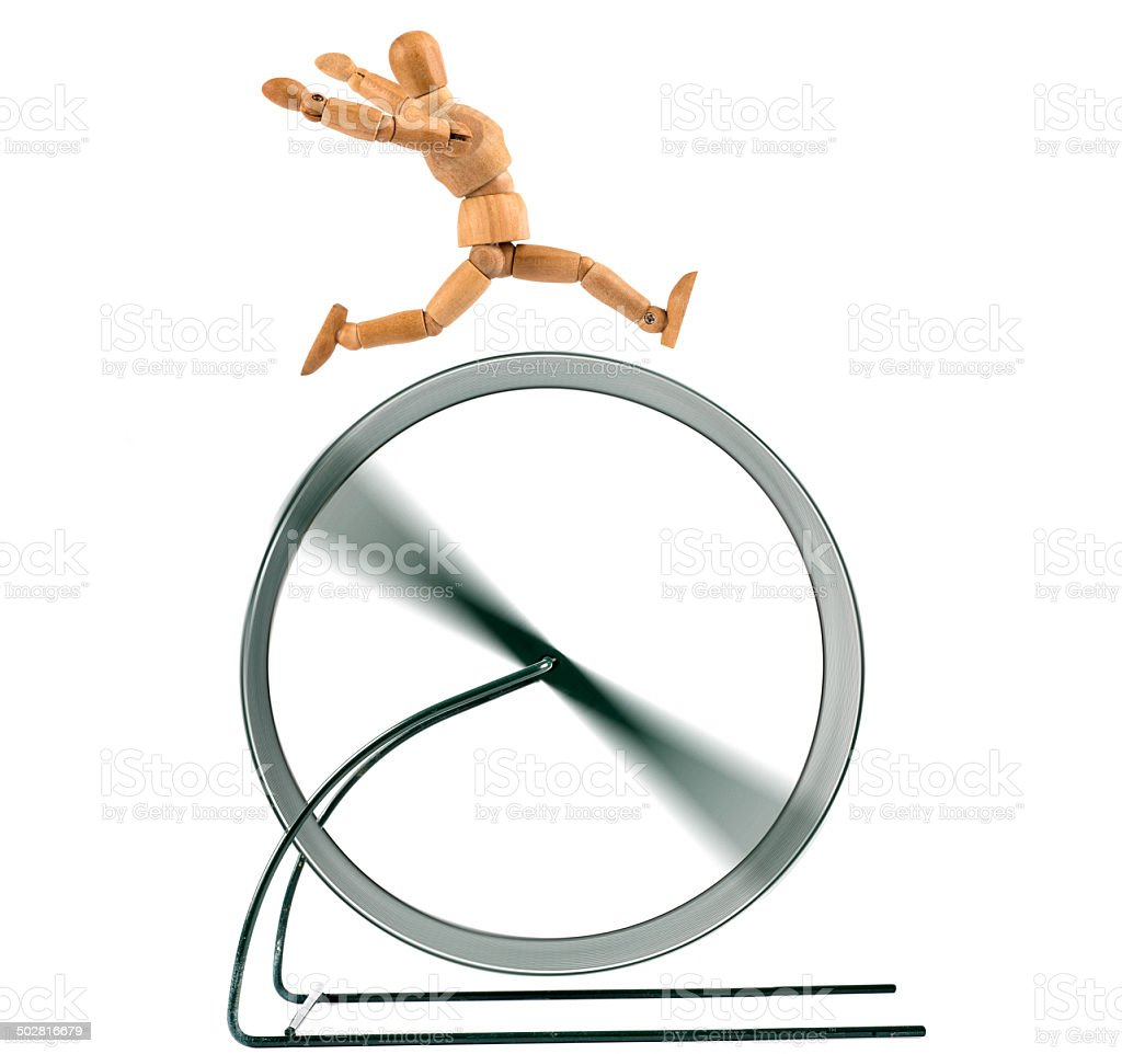 running in the treadmill   - wooden mannequin without goal stock photo