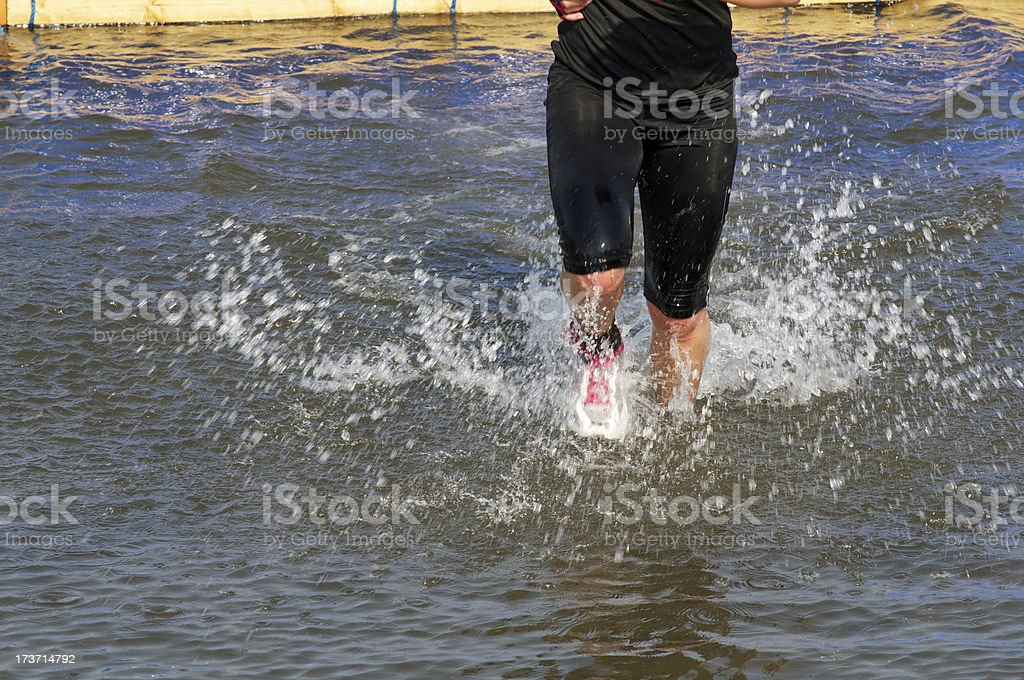 Running in water stock photo