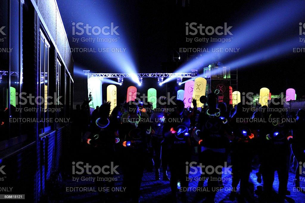 Running into the dark at Amsterdam Electric Run stock photo