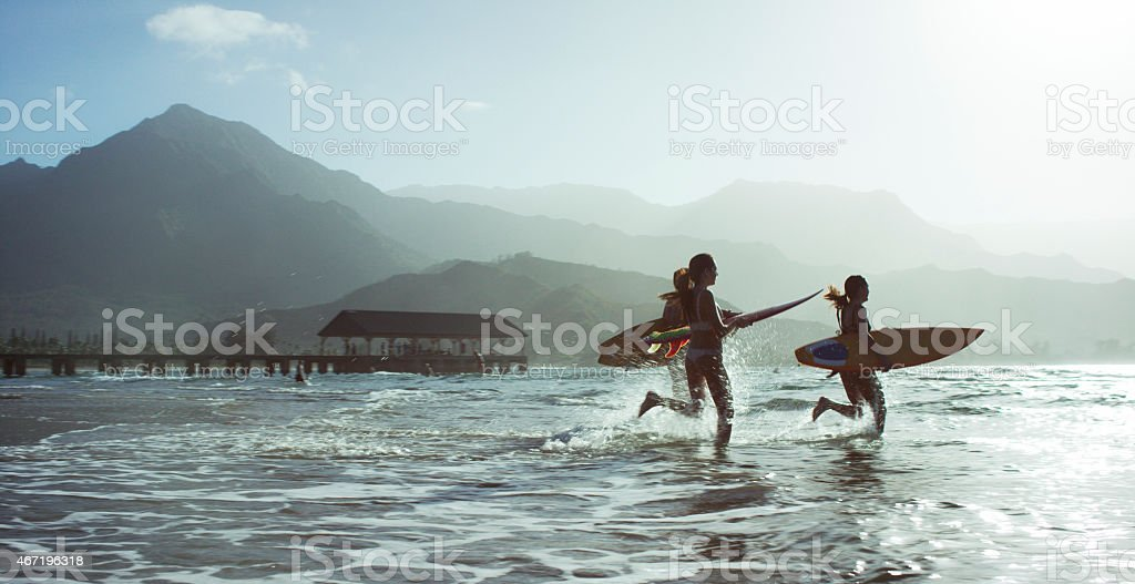 Running into the Ocean stock photo