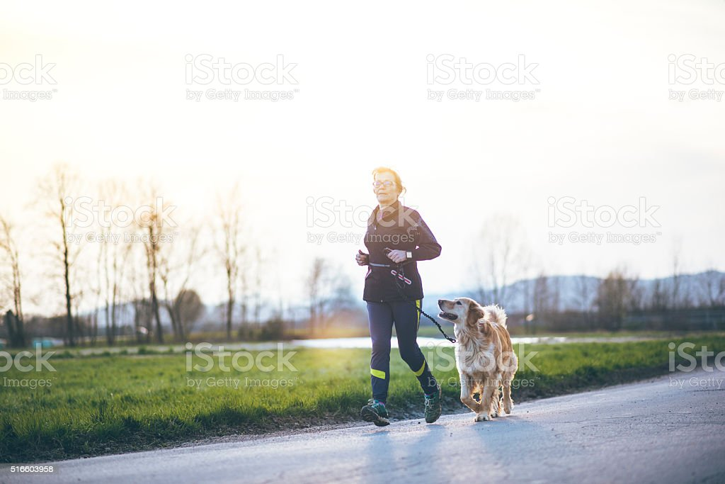 Running is better with a friend stock photo