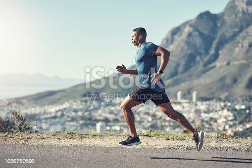 Shot of a young handsome man running outdoors