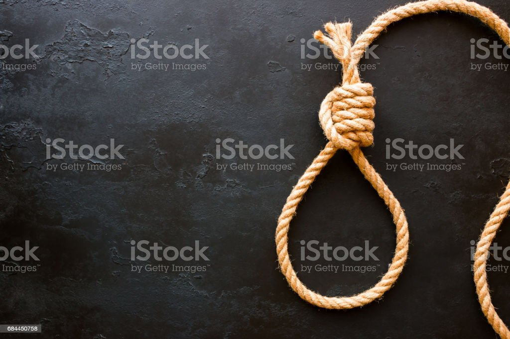 running knot of rope on a black background with space for text. Concept stop suicide stock photo