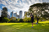 Young man running at sunset in a park, Sydney - Australia.