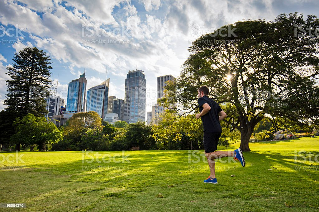 Running late afternoon stock photo