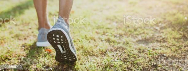 Running man feet ready for run at public park healthy lifestyle and picture id1045895212?b=1&k=6&m=1045895212&s=612x612&h=cjo4qzq9sbdmxzn9iwykalt4n3rswoq2nqbot5zbjzc=