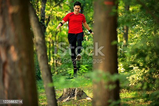 485902386 istock photo Running man. Male runner jogging at the park. Guy training outdoors. Exercising on forest path. Healthy, fitness, wellness lifestyle. Sport, cardio, workout concept 1225883214