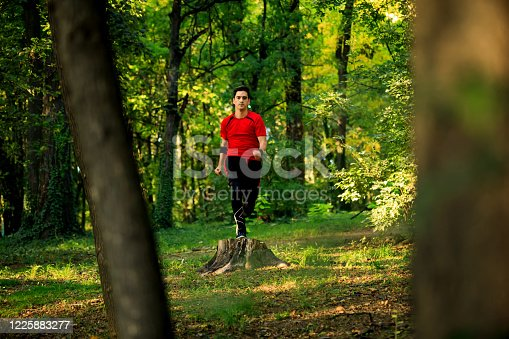 485902386 istock photo Running man. Male runner jogging at the park. Guy training outdoors. Exercising on forest path. Healthy, fitness, wellness lifestyle. Sport, cardio, workout concept 1225883277