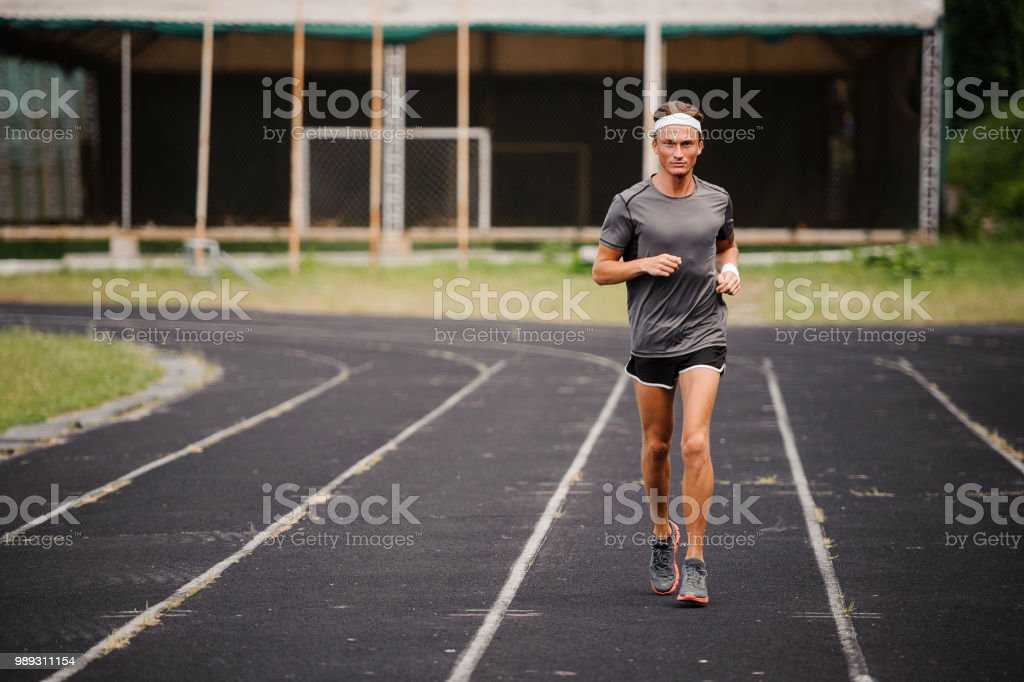 Running Man Runner Sprinting For Fitness And Health Stock Photo