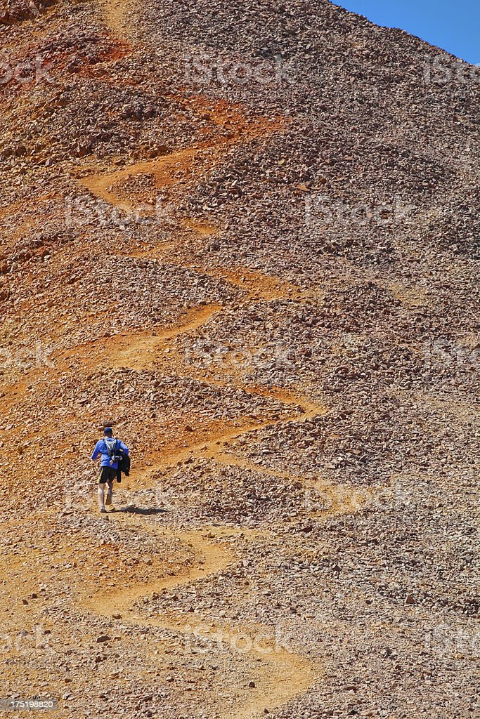 running man uphill stock photo