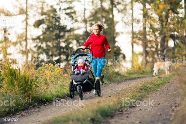 Running mother with stroller enjoying motherhood at autumn sunset picture id914817302?b=1&k=6&m=914817302&s=612x612&h=kqwu9gcqa4iwbpnvhhlhutz8a6hg8ni84izjvachiwe=