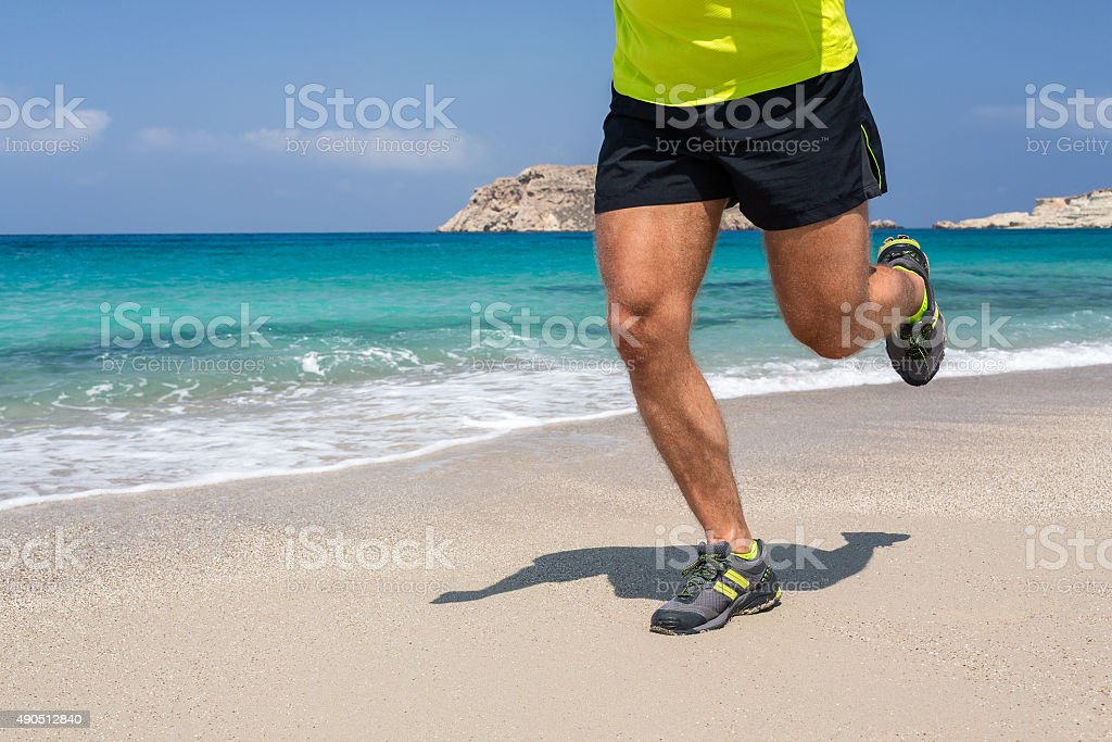 Running on a sandy beach. stock photo