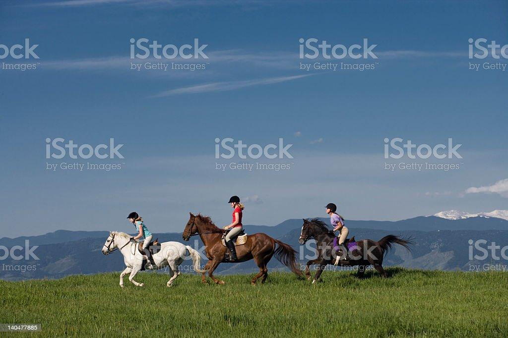 Running on horseback stock photo