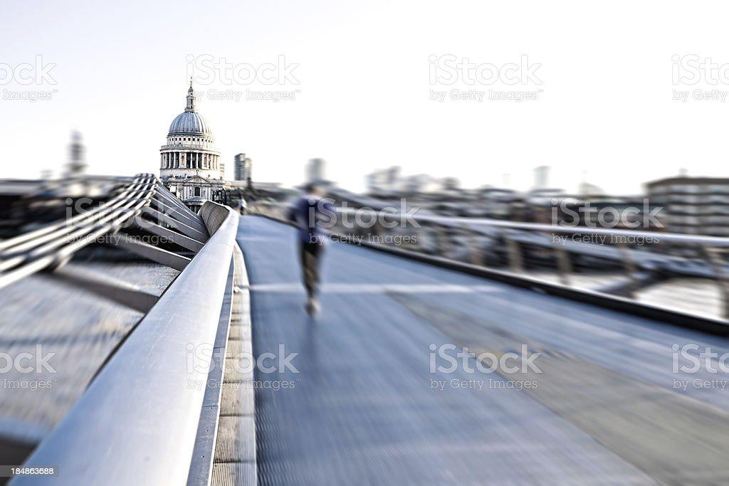 Running on London Millennium Bridge stock photo