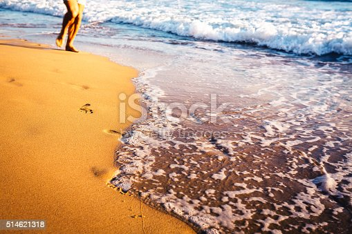 174919648 istock photo Running On The Beach 514621318