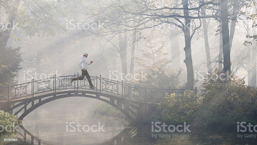 Running on the foggy morning royalty-free stock photo