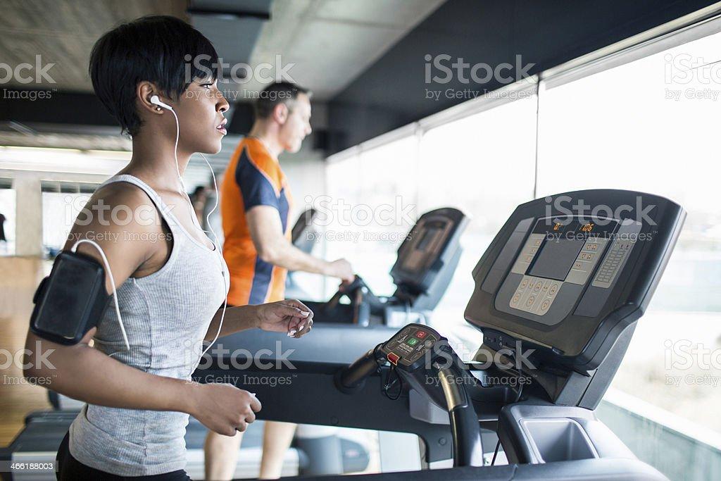 Running on the treadmill stock photo
