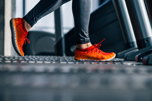 Running on treadmill in the gym. Running on treadmill in the gym. treadmill stock pictures, royalty-free photos & images