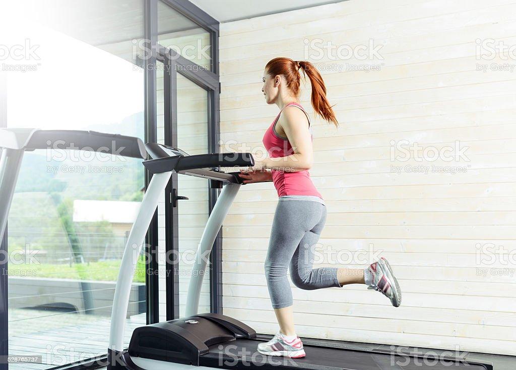 running on treadmill woman stock photo