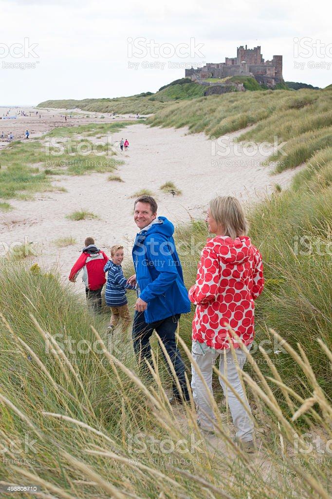 Running onto the beach stock photo