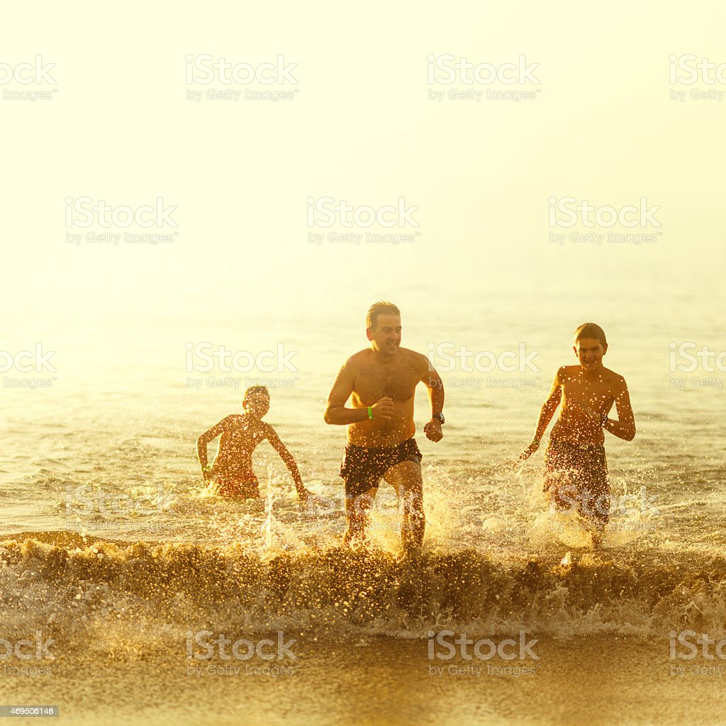 Running out of the beach stock photo